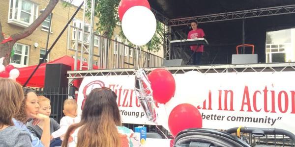 Aleks performing on stage